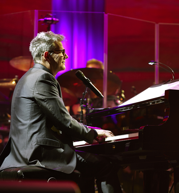 David Foster performs on piano
